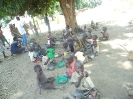 Children gathering to eat after class in Lakya village, 2014._1
