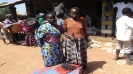 A blind woman (right) accompanied by her daughter to receive the S/NFI items